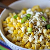 A bowl filled with corn, with Mexican Street Corn Salad