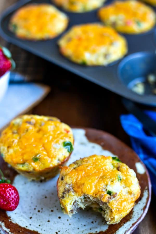Gluten-Free Sausage Egg Muffin on a speckled plate with one bite out