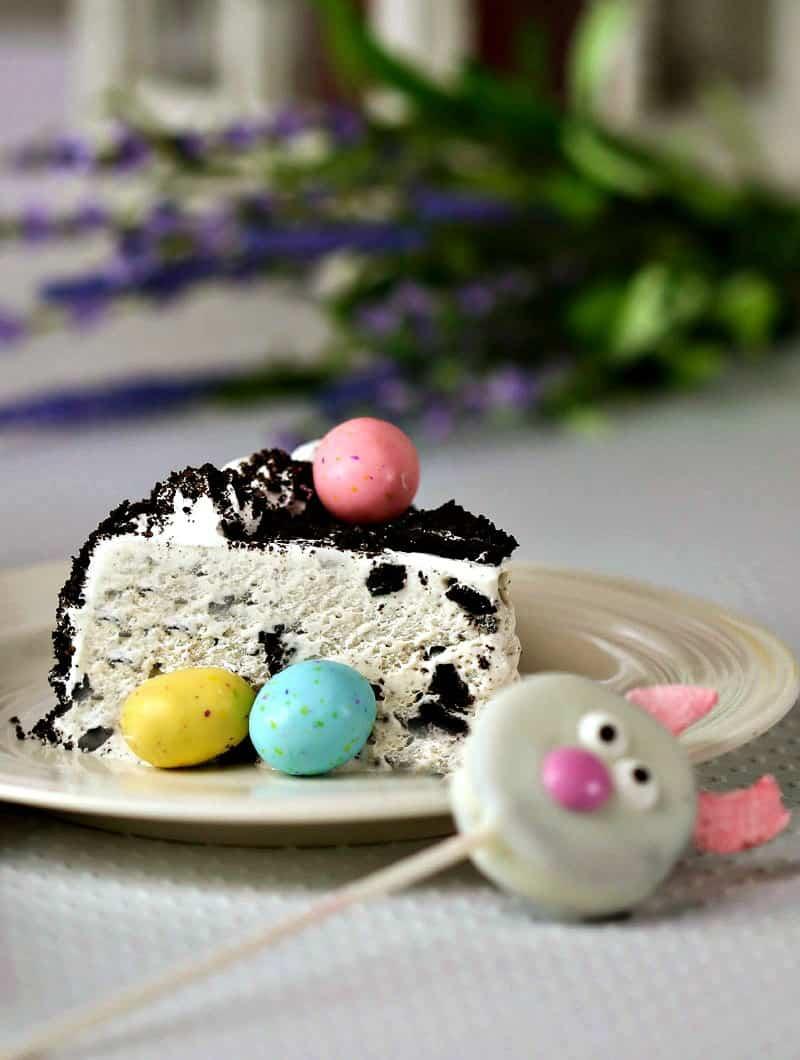 A close up of a slice of Oreo ice cream cake