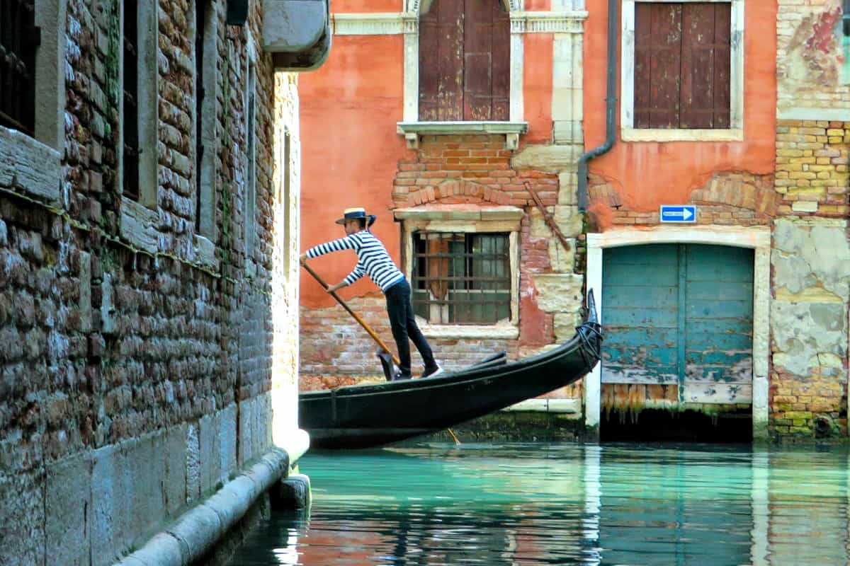 A boat gondola sitting in front of a brick building