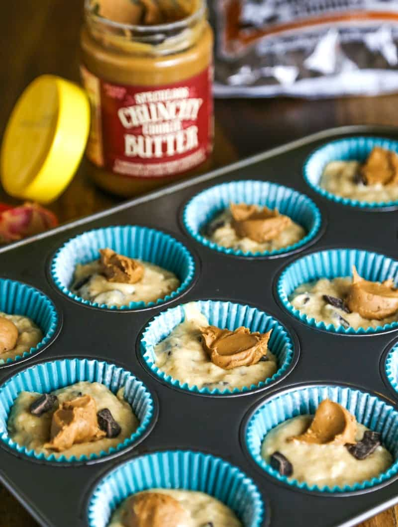 batter in paper cups in a muffin pan