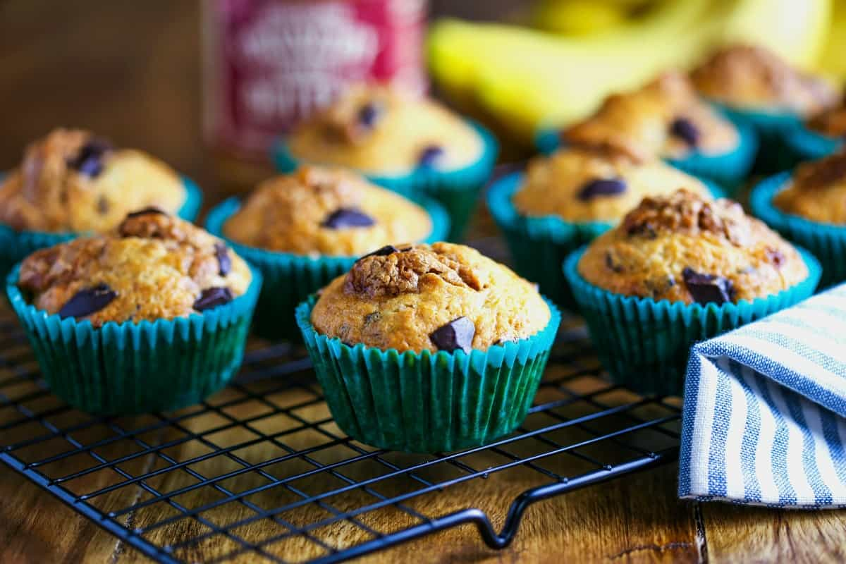 banana cookie butter muffins sitting on a wire rack