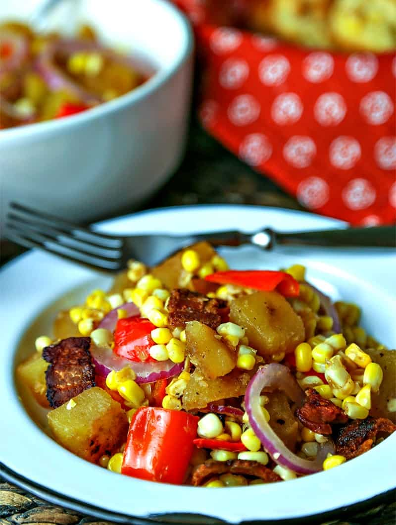 A plate of food on a table, withwarm corn chowder salad