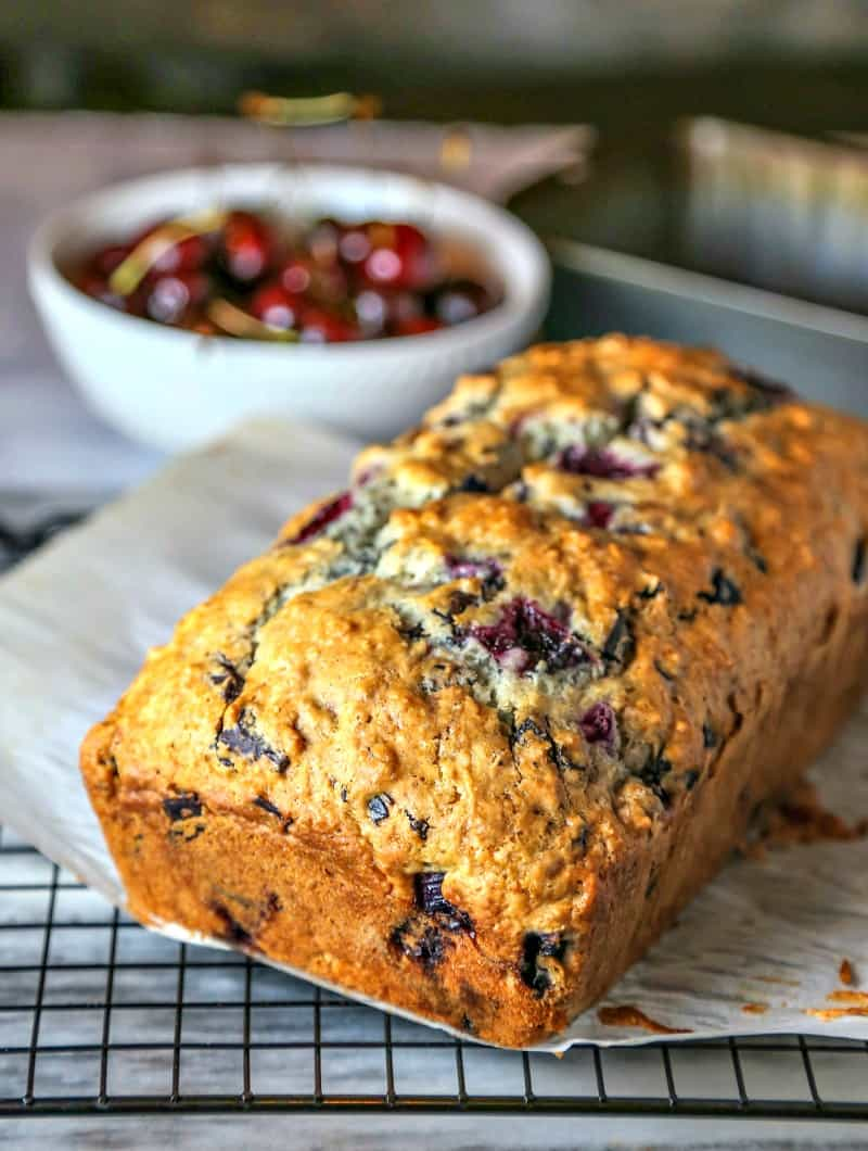 A close up of a loaf of cherry chocolate quick bread