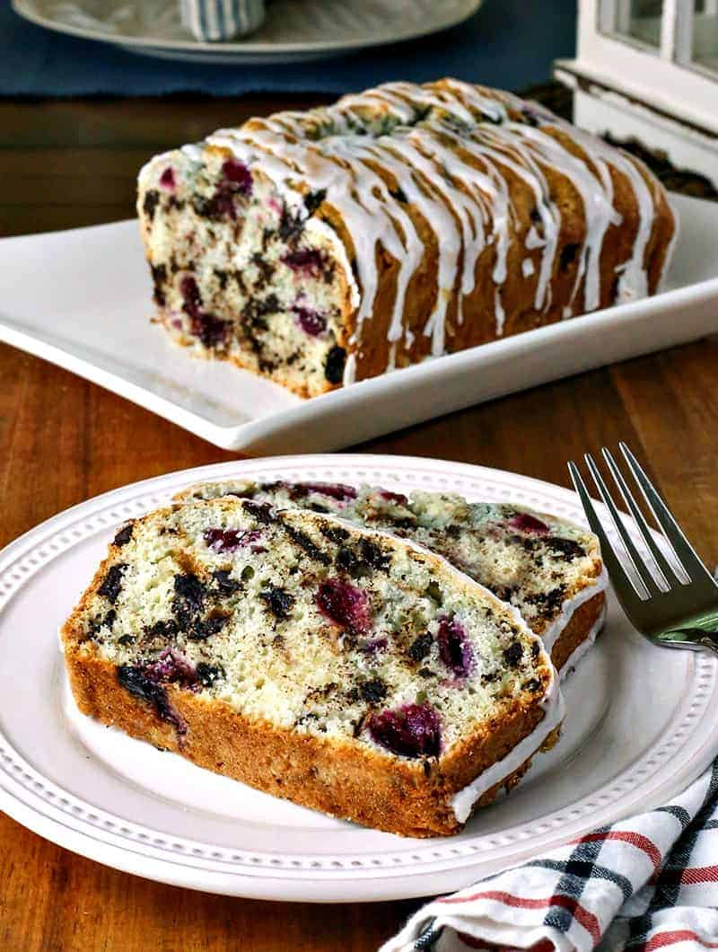 A plate of food with a slice of cherry chocolate loaf cake