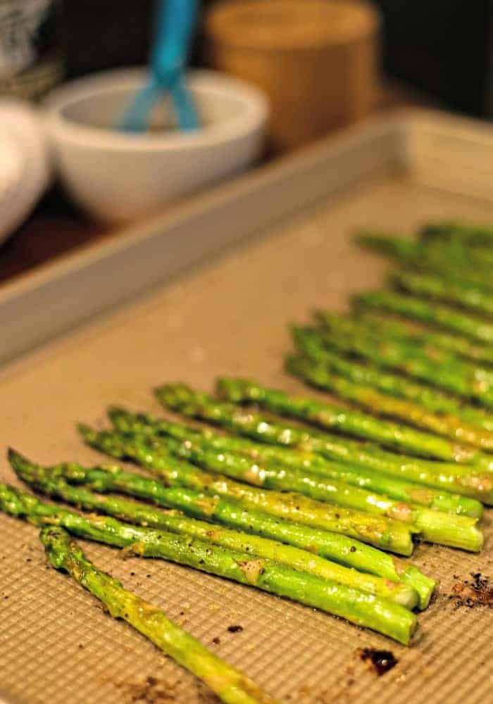 A baking sheet with asparagus