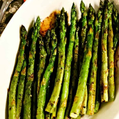 A plate of food, with asparagus