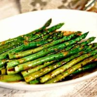 A plate of food with asparagus