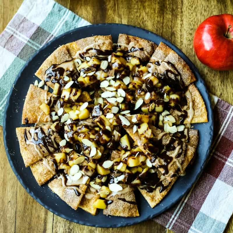 Apple Pie Nachos on a plate with chocolate ganache drizzled on top