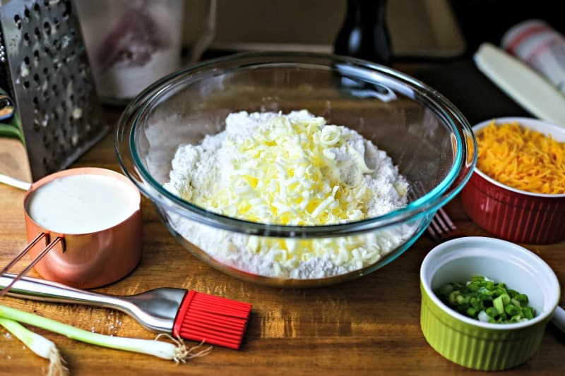 A bowl of flour with grated butter for mixing scones