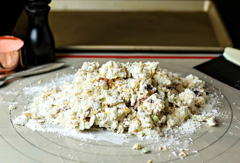 scone dough on a floured board on a table