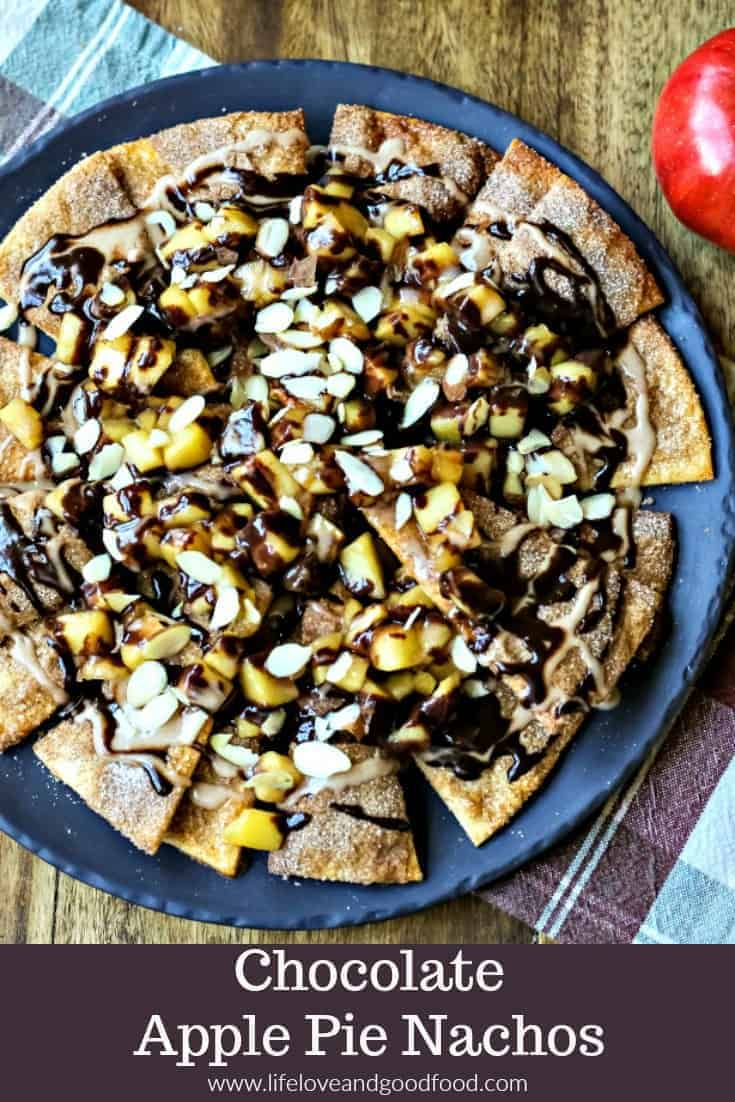 "CHOCOLATE Apple Pie Nachos make a fun party dessert. Cinnamon pie dough ""tortilla chips"" are loaded with a brown sugar apple compote, decadent chocolate ganache, a cinnamon glaze, and slivered almonds. #apple #chocolate #pie #nachos #dessert #recipe #partyfood #ganache"