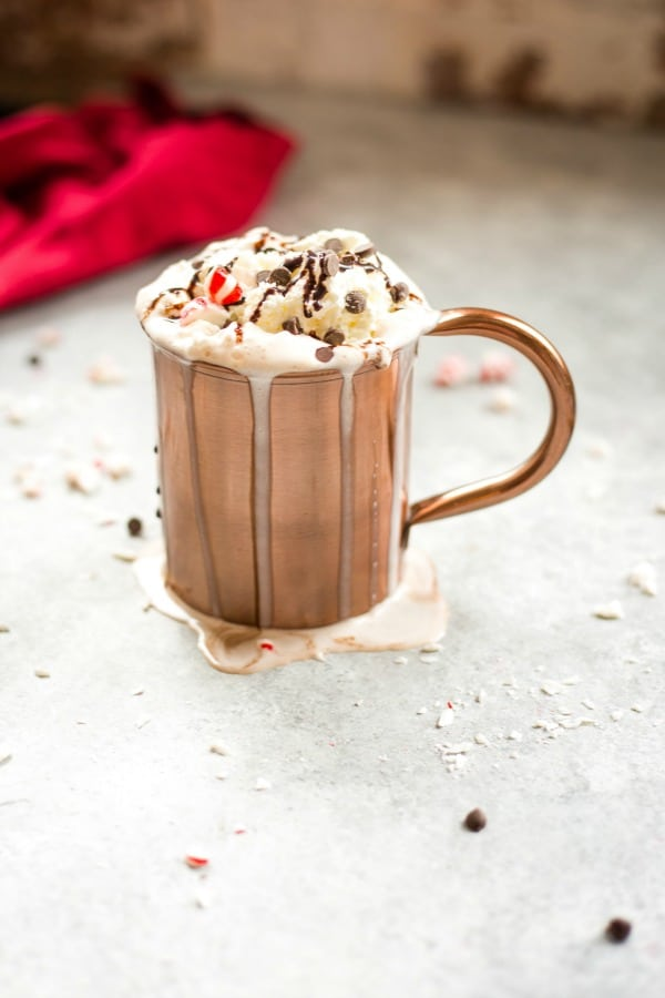 Dark chocolate peppermint mocha in a copper cup with whipped cream