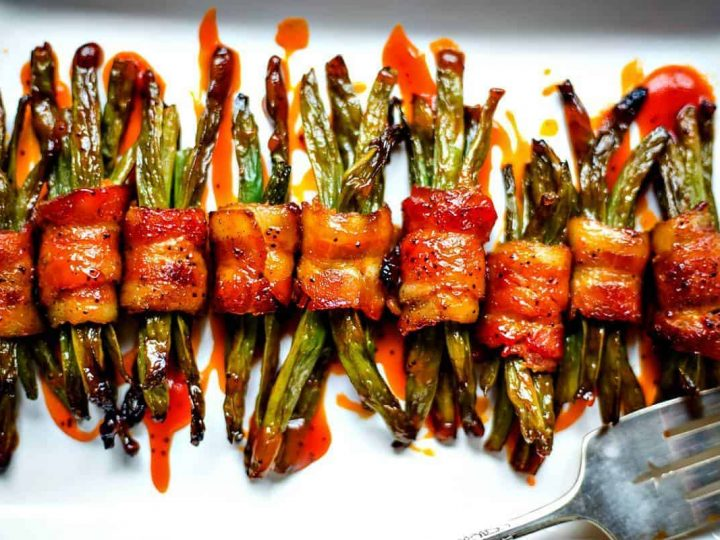 Bacon Wrapped Green Bean Bundles on white serving tray