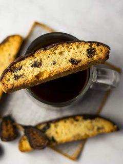 Fig Walnut Chocolate Dipped Biscotti on top of coffee cup