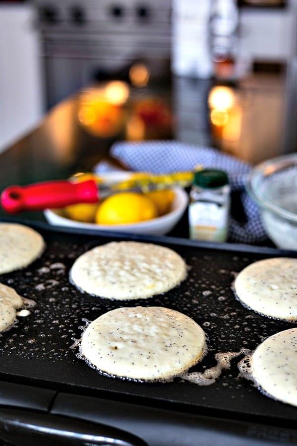 Lemon Poppy Seed pancake batter on a buttered griddle