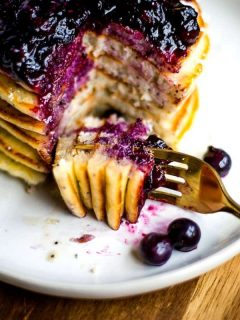 Lemon Poppy Seed Pancakes with Blueberry Compote on a fork