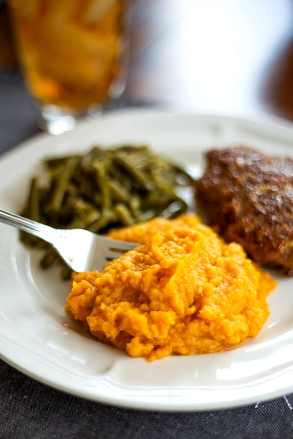 Mashed Sweet Potatoes on dinner plate with green beans and meatloaf