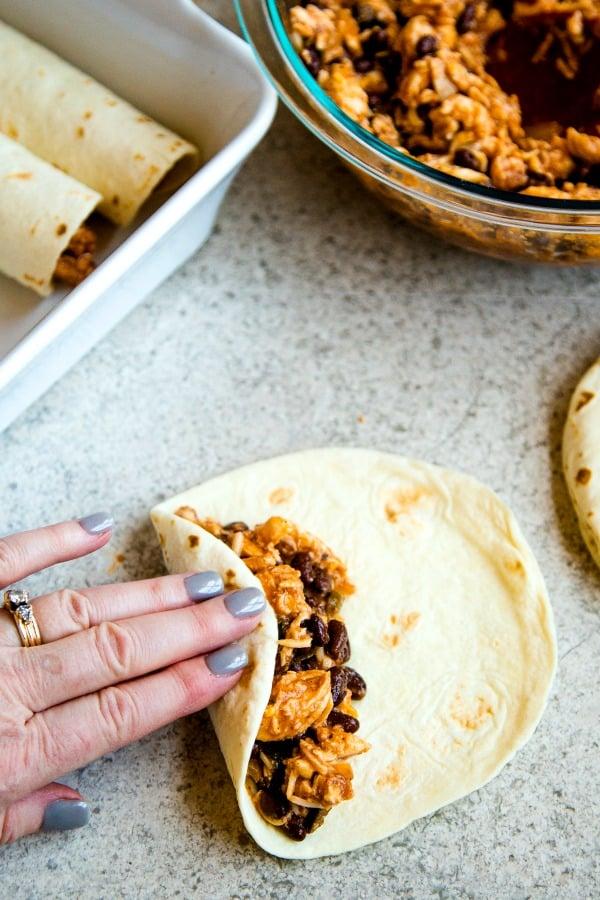 Chicken Black Bean Enchiladas - rolling enchiladas