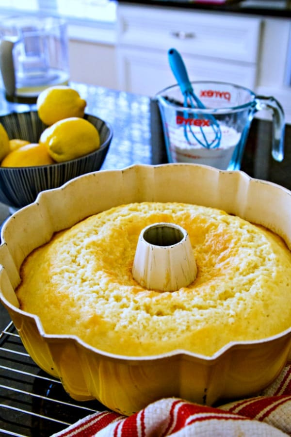 cake cooling in a bundt pan on a wire rack