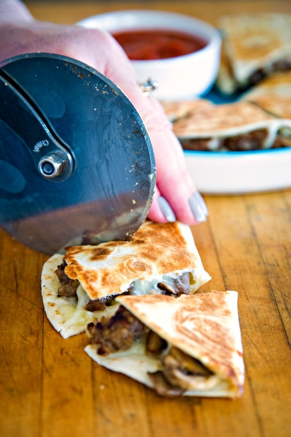 Cutting pizza-dillas with pizza cutter