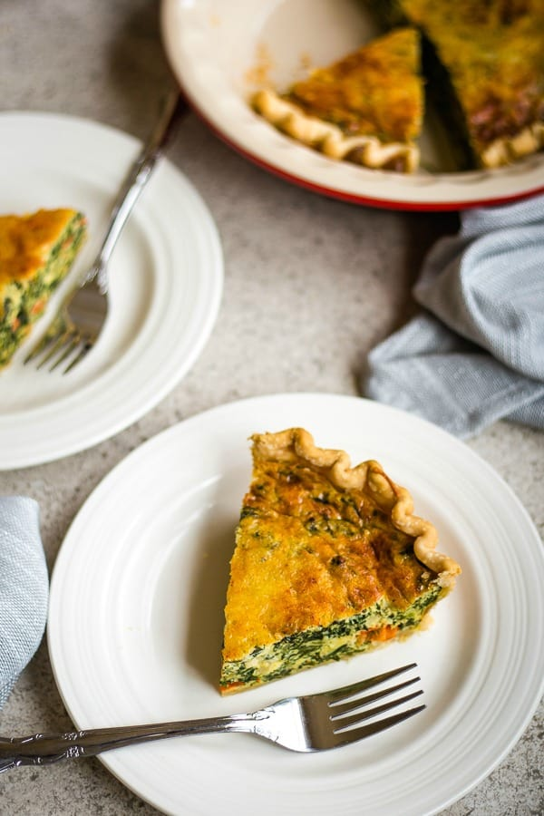 a wedge of spinach quiche