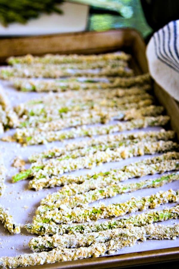 breaded asparagus on parchment paper