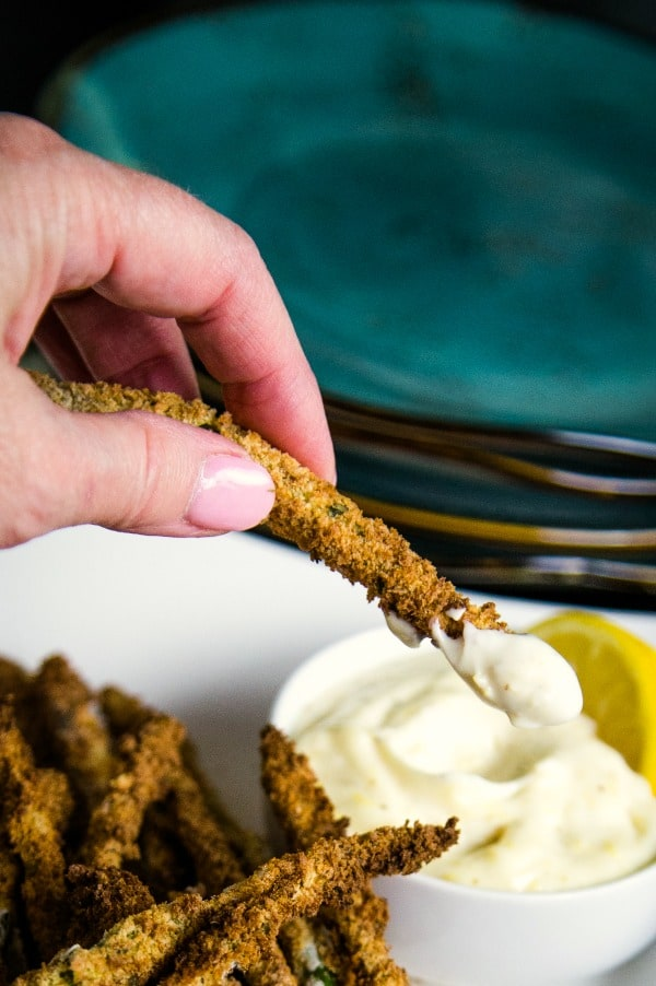 dipping asparagus fry in lemon aioli