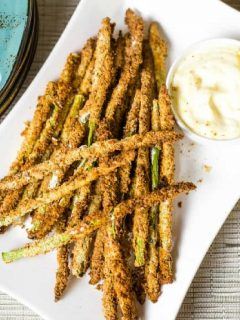 Air Fryer Asparagus Fries with Lemon Aioli on white platter.