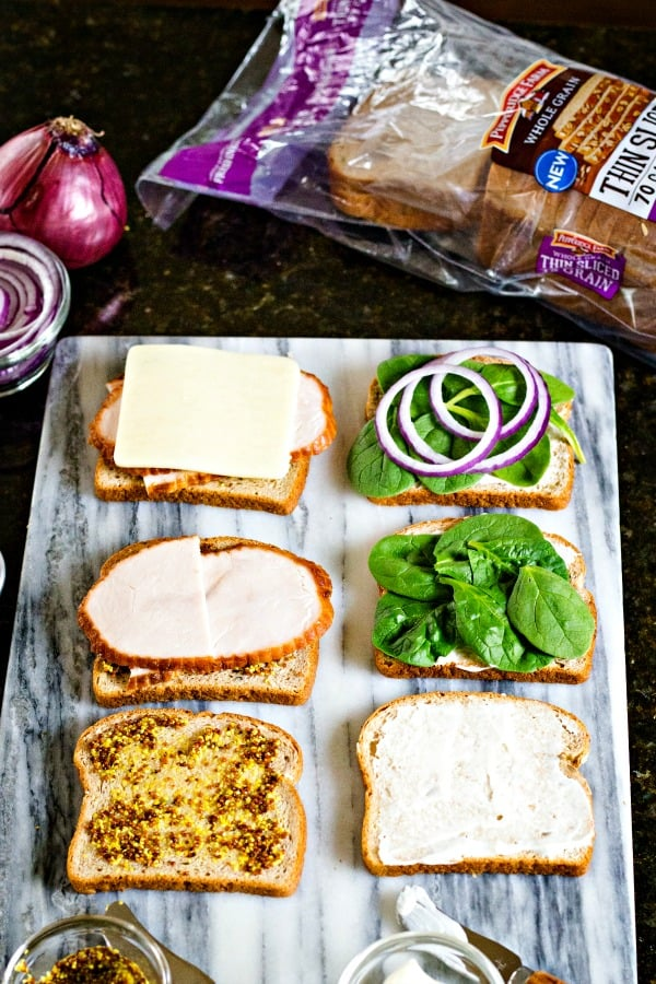 assembling turkey melt sandwiches