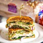 turkey melt sandwich on a white plate