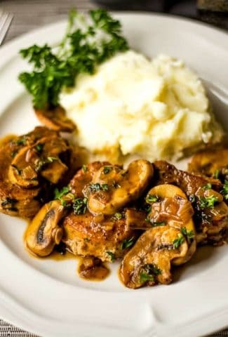 Pork Medallions in Mushroom Marsala Sauce with mashed potatoes on a plate