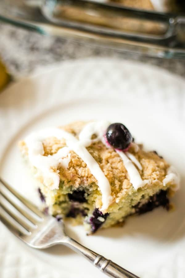 blueberry crumb cake with a bite missing