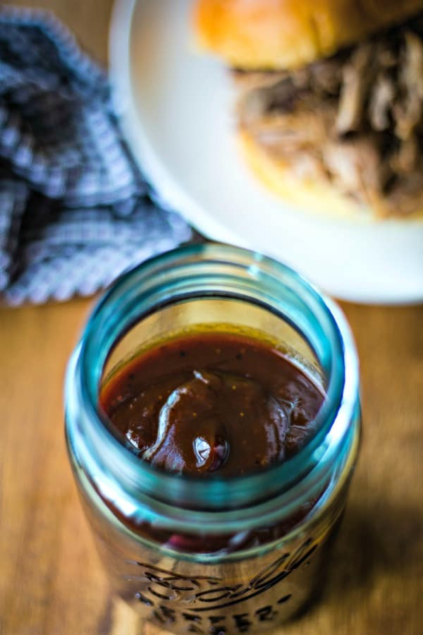 A jar of barbecue sauce on a table