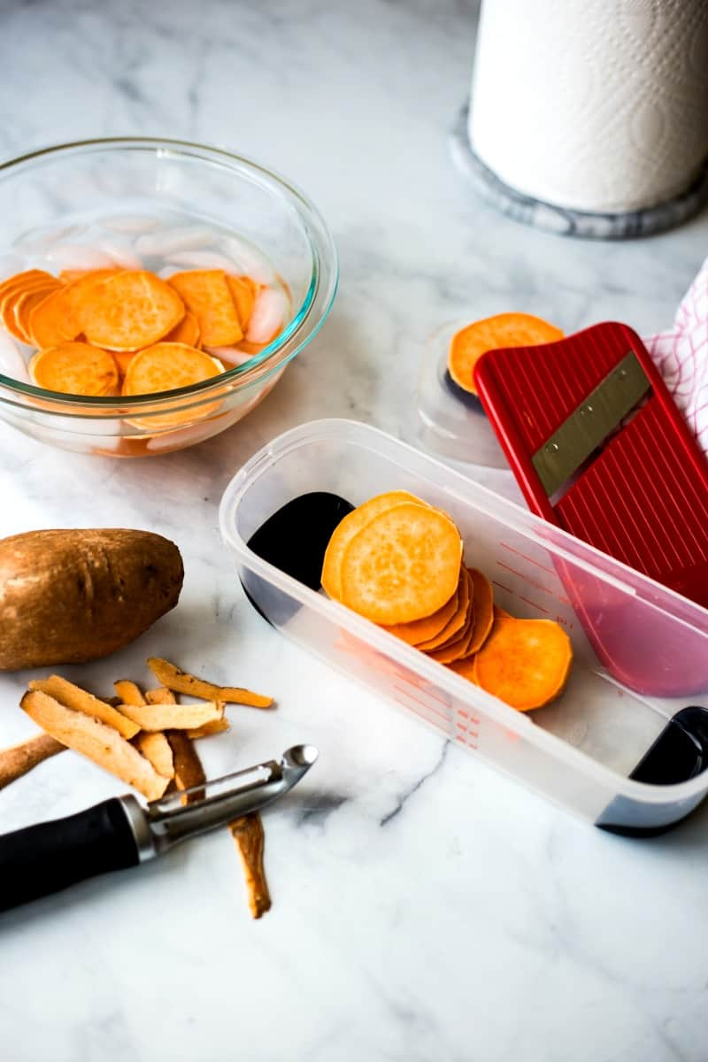 slicing sweet potatoes with a mandoline