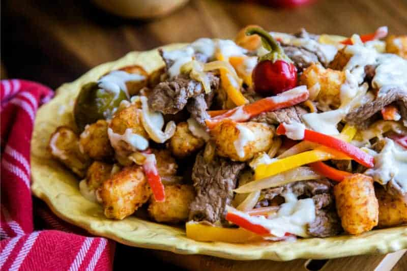 A plate of food on a table, with Beef and peppers
