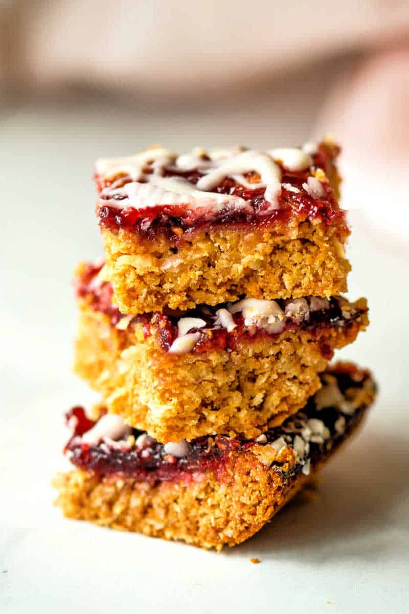 a stack of raspberry oatmeal bars stacked on top of each other