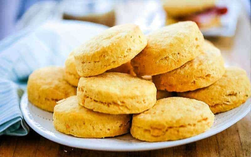a stack of Buttery Sweet Potato Biscuits on a white plate