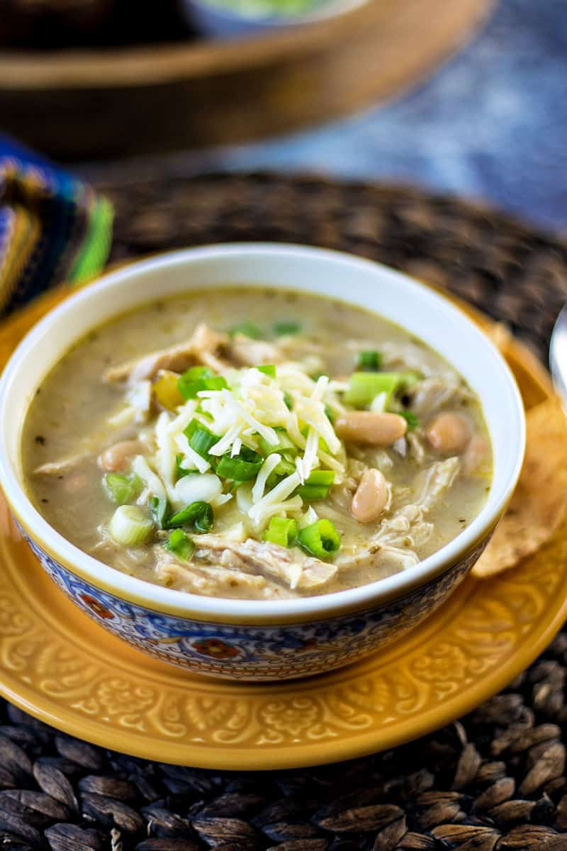 Instant Pot White Chicken Chili gets a kick 'o spice from garlic, cumin, oregano, and red cayenne pepper, while it gets a creamy broth from Monterey Jack cheese. Chock full of tender, juicy chicken and white beans, this easy pressure cooker soup can be ready to serve start to finish in about thirty minutes! #instantpot #pressurecooker #chili