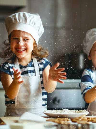 two children having fun baking