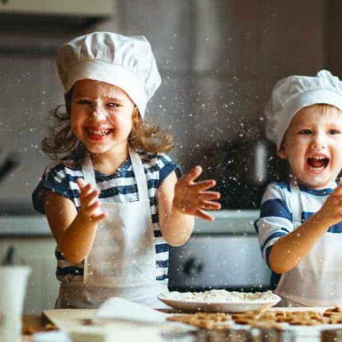 two children having fun baking