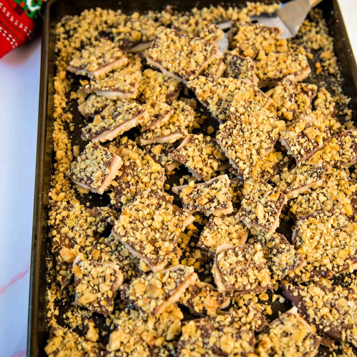 a cookie sheet with broken up pieces of English toffee