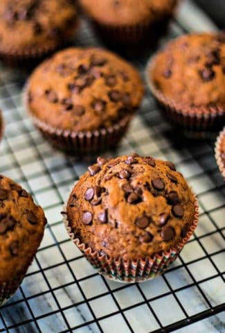 chocolate banana muffins on a wire cooling rack