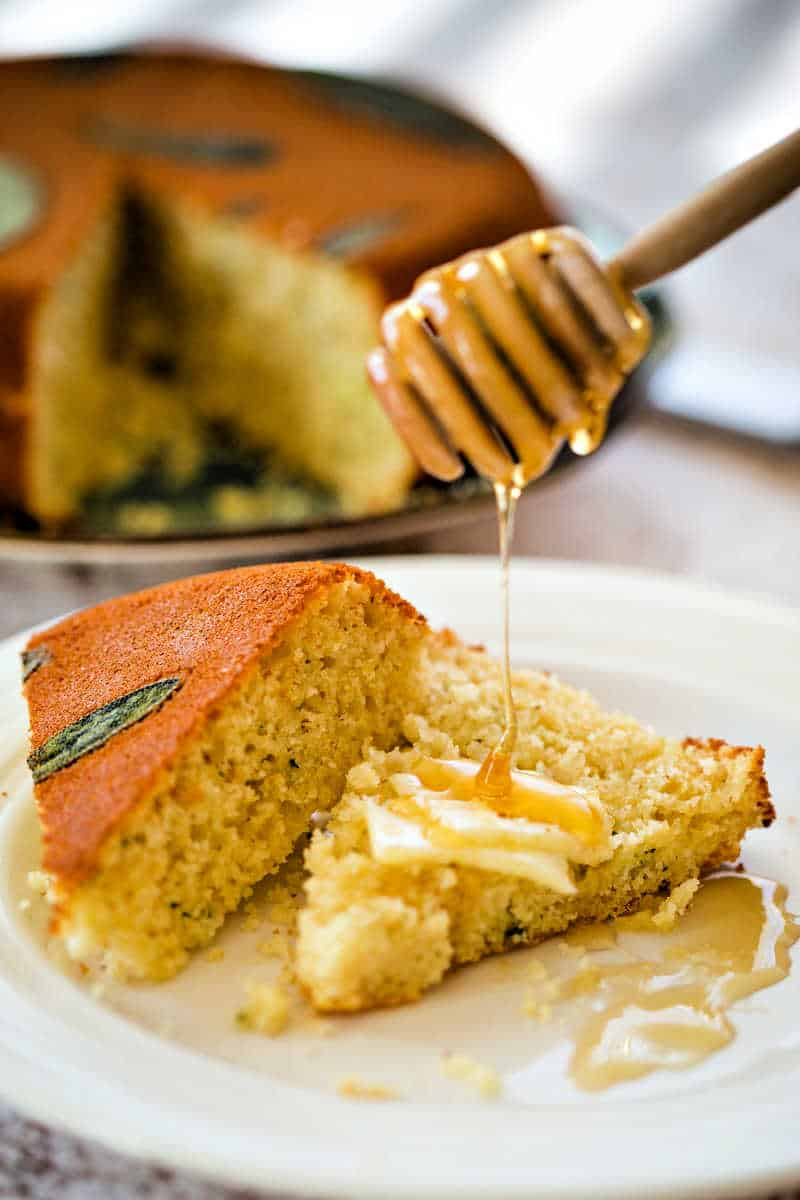 honey being drizzled onto Honey Cornbread with Sage