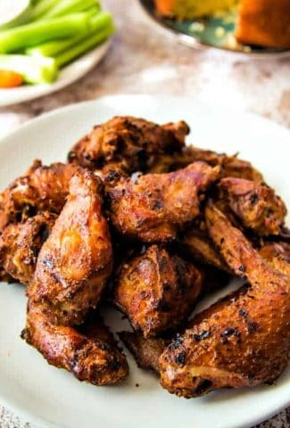 A plate full of food, with Smoked Chicken Wings