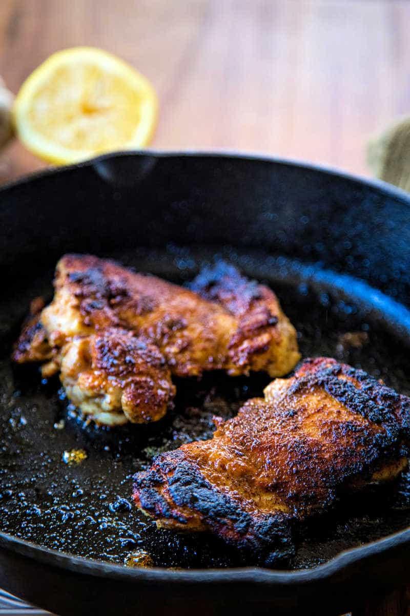 blackened chicken thighs in cast iron skillet