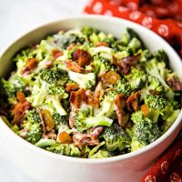 broccoli and bacon salad in a white bowl.
