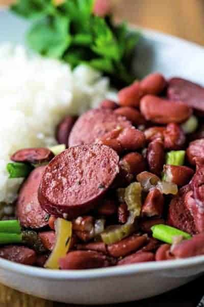 red beans and rice in a bowl garnished with parsley
