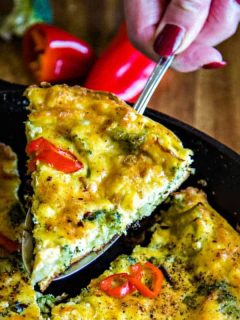 A plate of food with a slice of frittata, with Broccoli