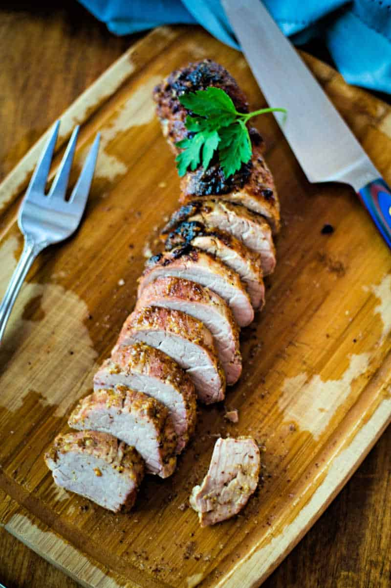 Maple Dijon Oven-Roasted Pork Tenderloin on a a cutting board